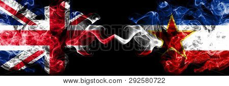United Kingdom Vs Yugoslavia Smoky Mystic Flags Placed Side By Side. Thick Colored Silky Smoke Flags