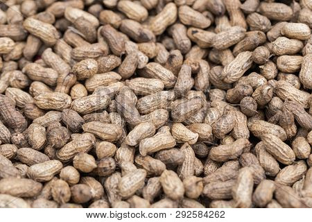 Pile Of Peanut In Shell Texture At Market For Food And Agriculture Concept Design. Peanuts. Roasted
