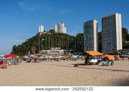 Sao Vicente, Brazil - July 2018:  People Enjoy A Public Beach On A Warm, Sunny Day Along The Coast O
