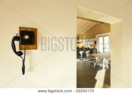 view of the kitchen and phone vintage on the wall