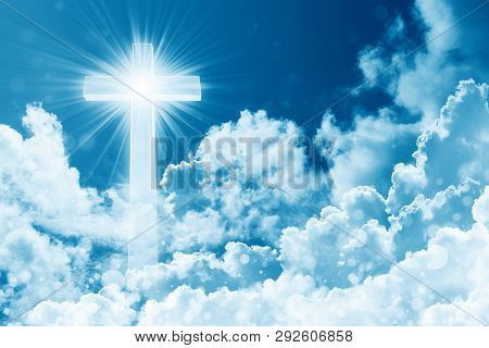 Concept Of Christian Religion Shining Cross On The Background Of Cloudy Sky. Sky With Cross And Beau