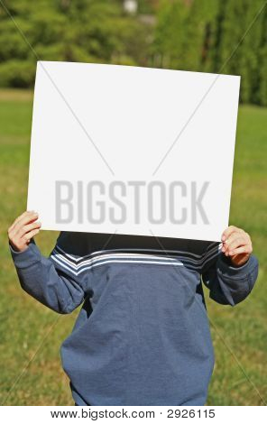 Child Holding A Blank Sign