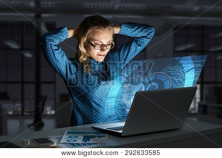 Attractive Woman Working On Laptop And Lock Icon Out Of Screen. Mixed Media