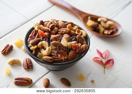 Mix Nuts And Dried Fruits Background And Wallpaper. Seen In Top View Of Mix Nuts And Dried Fruits In