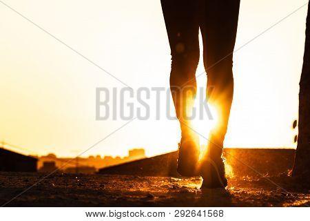 Silhouette Of Man Legs Running Under Sunset - Guy Jogging In A Park In The Sunset Or Sunrise. Sunris