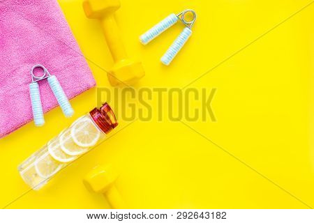 Fitness Background With Sport Equipment For Gym And Home On Yellow Background Top View Copyspace