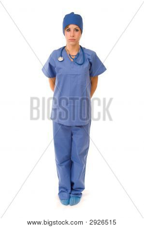 Female Doctor In Scrubs Isolated On White