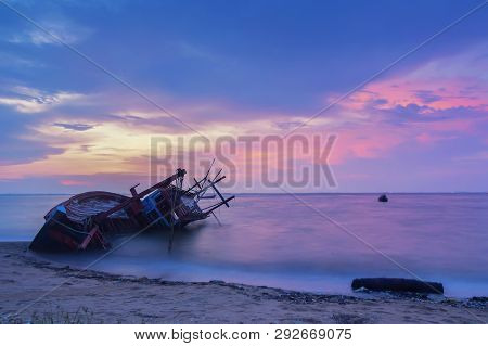 An Old Shipwreck Or Abandoned Shipwreck On The See Blue Sky Background.
