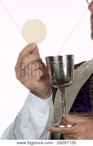 A Catholic priest with a chalice and host at Communion