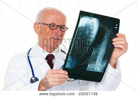 A radiologist with an X-ray image in the doctor's office.