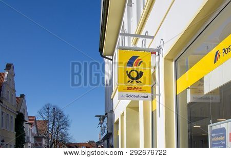 Verden, Niedersachsen, Germany March 31, 2019: A Hanging Sign Outside A Branch Of The German Postban