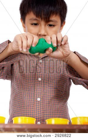 kid playing dough trying to form an object poster