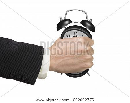 Seizing The Time And Present Opportunities Concept. Businessman Hand Grasping Alarm Clock, Isolated