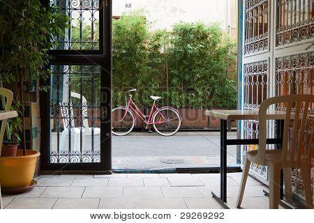 pink bicycle through gateway
