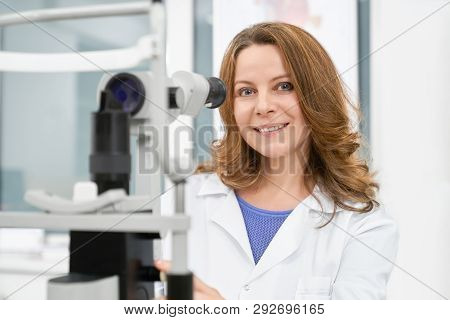 Doctor Optometrist, Beautiful Woman Working In Medical Clinic And Examining Eyesight. Ophthalmologis