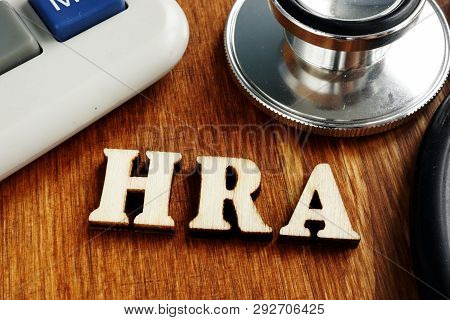 Health Reimbursement Account Hra Wooden Letters On Desk.