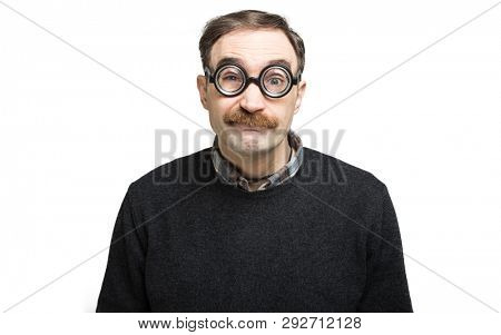 Funny portrait of a ner mand wearing nerd glasses