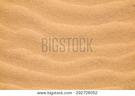 Beautiful Nature Sandy Background. Abstract Pattern Of Sea Sand. Wave Of Sand On Sea Coast Formed By