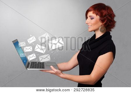 Man holding laptop with business communication concept