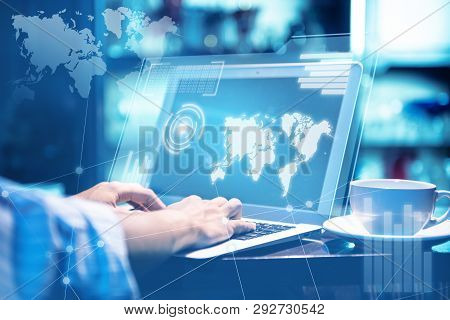Businessman Working With Laptop Which Display The Interface Of World Maps, Binary Code And Graph. Di