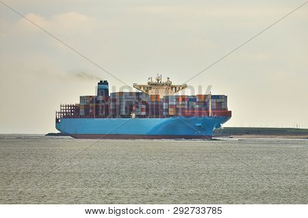 Container ship heading out on sea