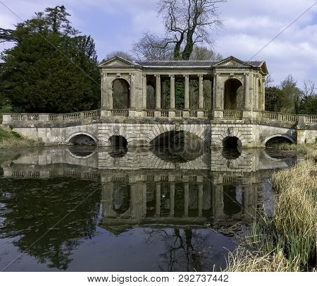 Stowe, Buckinghamshire, Uk - March 28: Octagon Lake And Palladian Bridge On Hawkwell Field On March