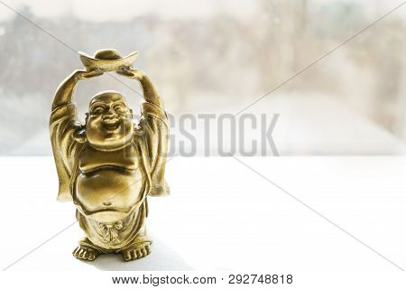 Budha Statue On Light Background . Copy Space . Top View. Place For Text