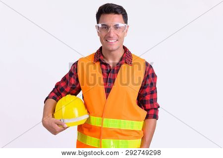 Young Happy Hispanic Man Construction Worker With Protective Glasses Smiling