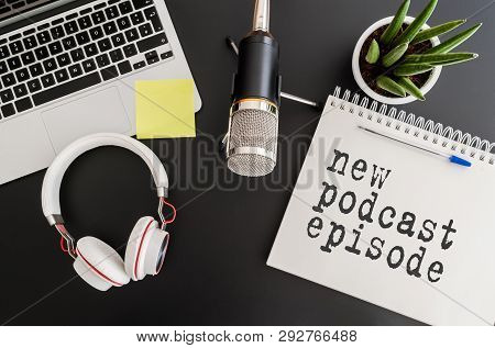 Top View Of Podcast Recording Equipment On Desk With Words New Podcast Episode Written On Note Pad