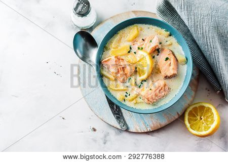 Top View Of Soup With Salmon, Cream And Potatoes In A Blue Bowl