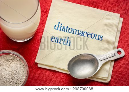 food grade diatomaceous earth supplement - powder and in a glass of water with a measuring spoon and a napkin with text