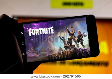 April 1, 2019, Brazil. Play Fortnite On The Screen Of The Mobile Device. Fortnite Is An Online Multi