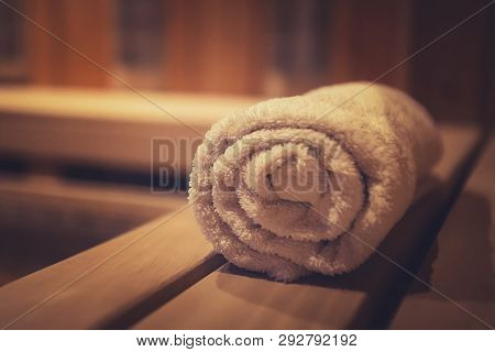 A Close Up Of A Soft Terry Bath Towel In A Wooden Steam Sauna. Comfortable Rest In A Traditional Rus