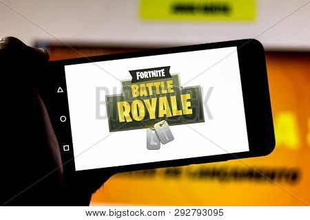 April 1, 2019, Brazil. Logo Fortnite Battle Royale On The Screen Of The Mobile Device. Fortnite Is A