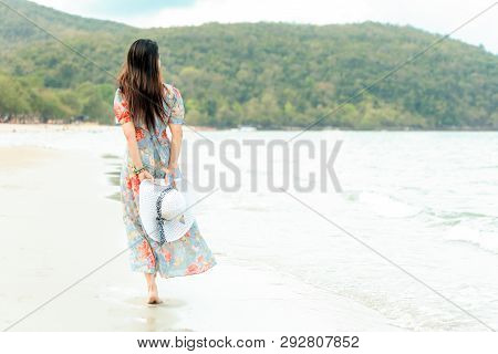 Summer Holiday. Lifestyle Woman Chill Holding Big White Hat And Wearing Fashion Summer Trips Walking