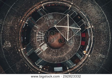 Aerial closeup view of Tulou, the unique dwellings of Hakka in Fujian, China. poster