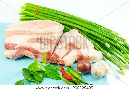 Streaky Pork On Blue Block With Vegetable On White Background