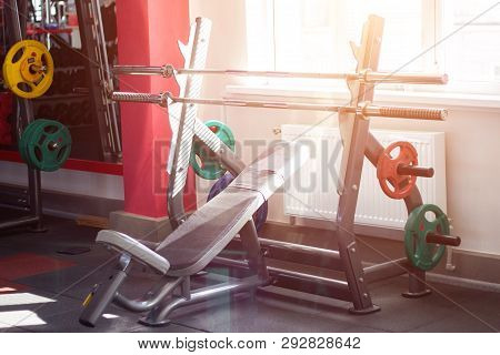Sports Bench With A Barbell And Discs On The Rack To Perform The Barbell Bench Press In The Modern G