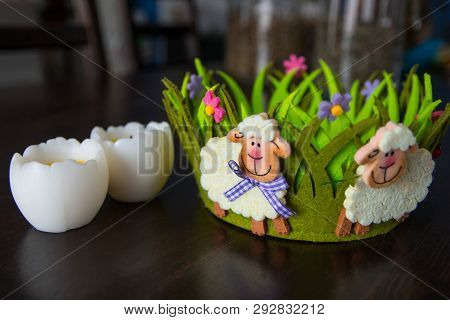 Easter Decor With Baa-lambs On The Green Basket And Eggs. Spring Holiday Easter Cute Scene On Wooden