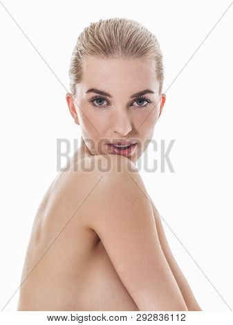 Portrait of blond woman face with natural make up on white background.