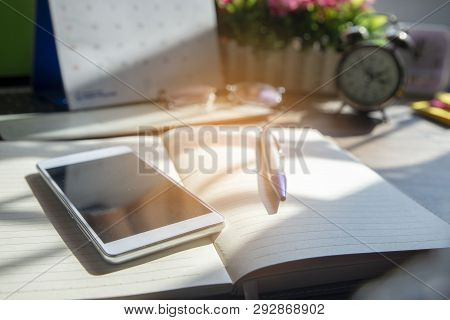 Diary And Smartphone For Planning Work Schedules And Appointments.desktop Laptop,calendar,clock,diar