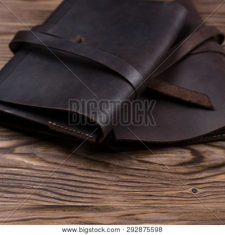 Two Brown Handmade Leather Notebook Covers On Wooden Background. Stock Photo Of Luxury Business Acce