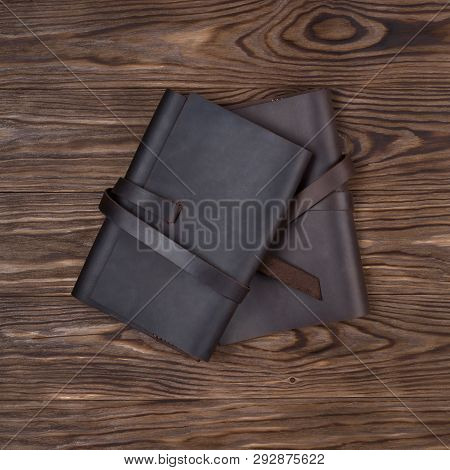 Black And Brown Handmade Leather Notebook Covers On Wooden Background. Stock Photo Of Luxury Busines