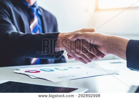 Business People Handshake Agreement In Office.