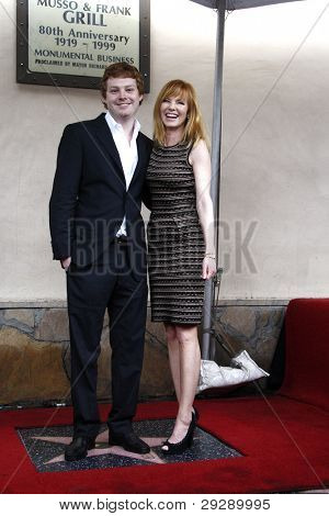 LOS ANGELES - JAN 23: Marg Helgenberger; son Hugh Rosenberg at a ceremony where Marg Helgenberger is honored with a star on the Hollywood Walk of Fame on January 23, 2012 in Los Angeles, California
