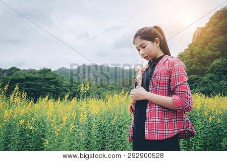 Young Beautiful Woman Praying On Nature Background