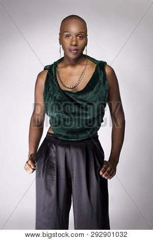 Black African American Female Fashion Model Posing With Trendy Bald Hairstyle And Stylish Clothing I