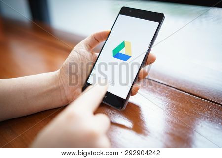 Chiang Mai, Thailand - Feb. 18,2019: Woman Holding Huawei With Google Drive Apps On Screen. Google D