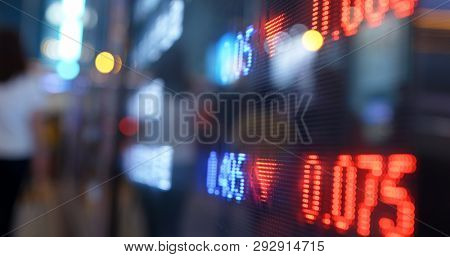 Stock market display screen in city at night