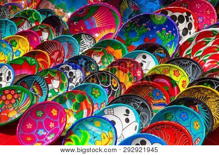 CHICHEN ITZA - FEBRUARY 19: Traditional mexican ceramics on the street market on February 19, 2019 in Chichen Itza, Mexico. Area around archeological site is popular local market for souveniers.